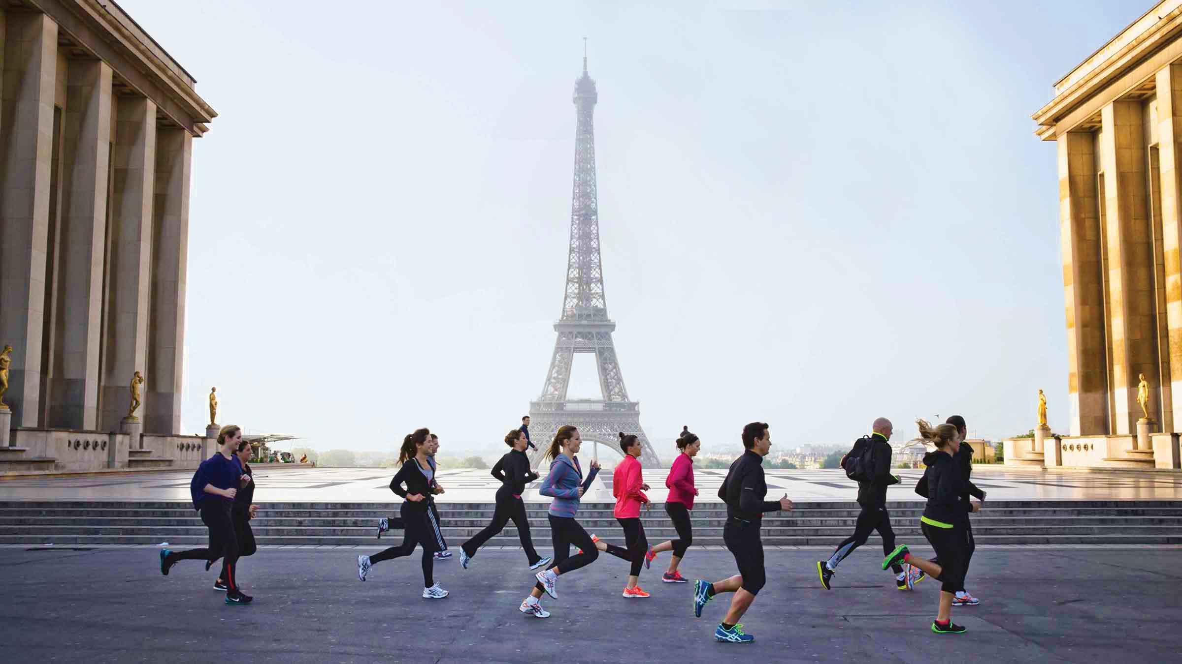 Four Seasons Hotel guests jogging past the Eiffel Tower—Paris, France