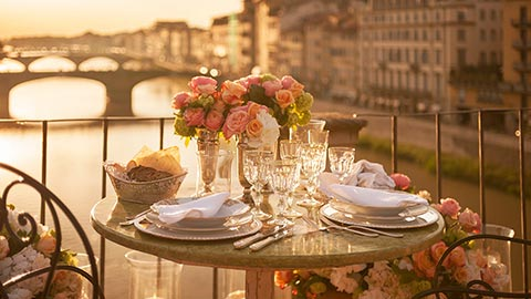 Enjoy a golden sunset dinner on the Ponte Vecchio