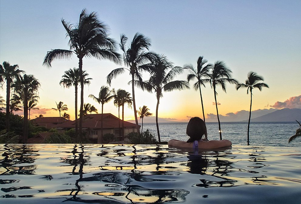 Woman in infinity pool at Four Seasons Maui
