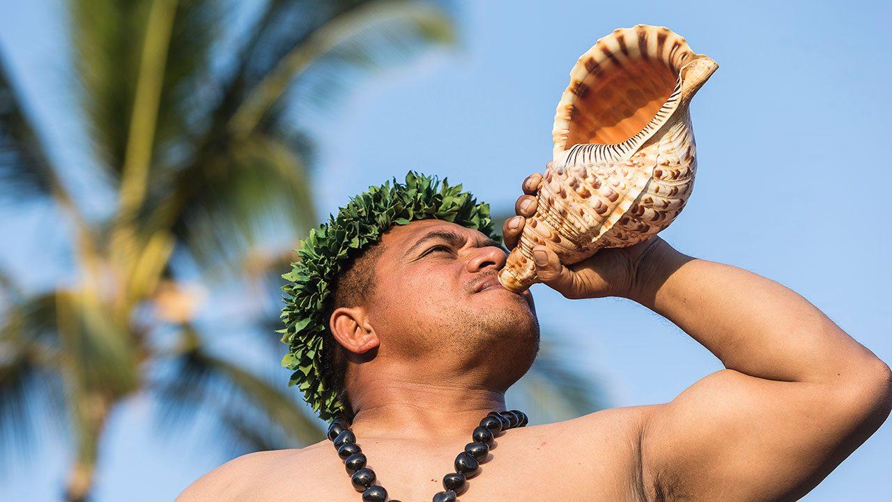 Conch Blowing at Four Seasons Lanai