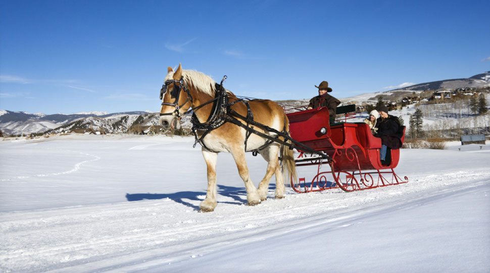 A couple takes a winter sleigh ride in Jackson Hole, Wyoming