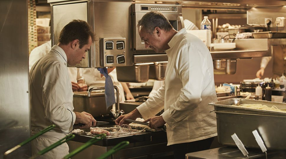 Chef Le Squer cooks in the kitchen at the Four Seasons Paris