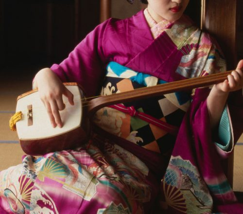 Geisha playing a shamisen