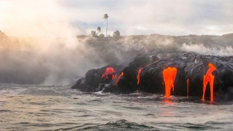 An overnight bucket-list experience of Kilauea, one of the world's most active volcanoes, with a custom helicopter odyssey