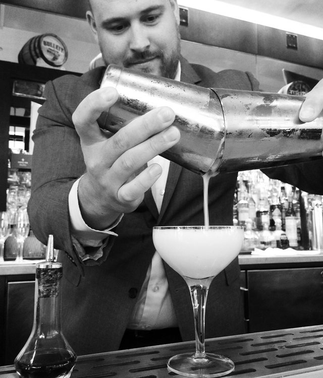 Guy Freshwater makes drinks at the Four Seasons Hotel Palo Alto.