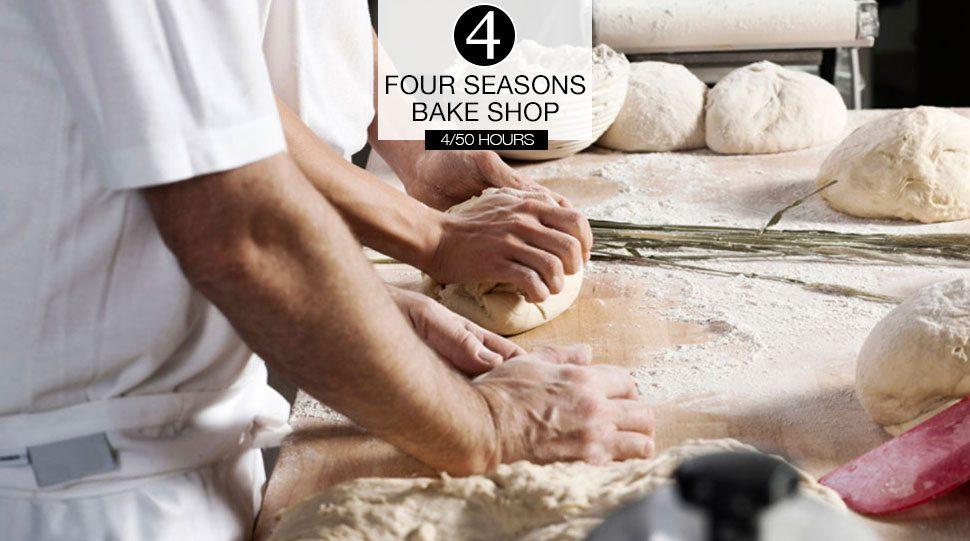 Chefs prepare dough in a kitchen.
