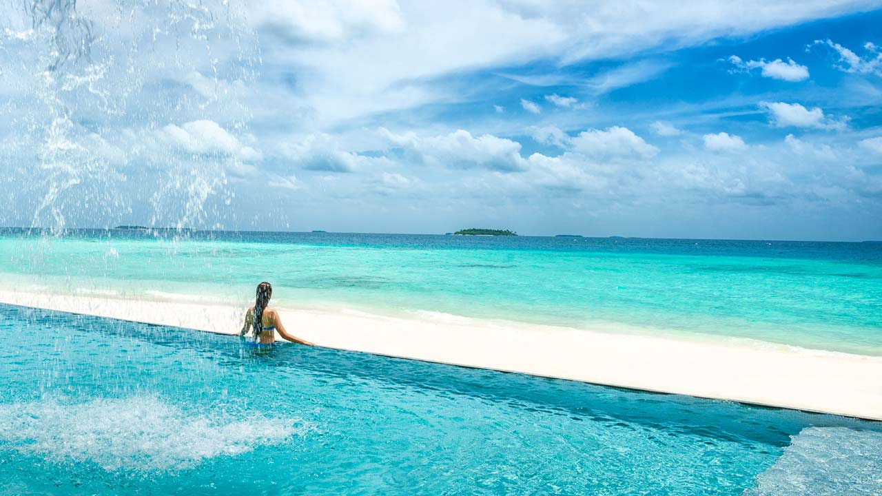 Blu beach infinity pool at Four Seasons Resort Maldives at Landaa Giraavaru
