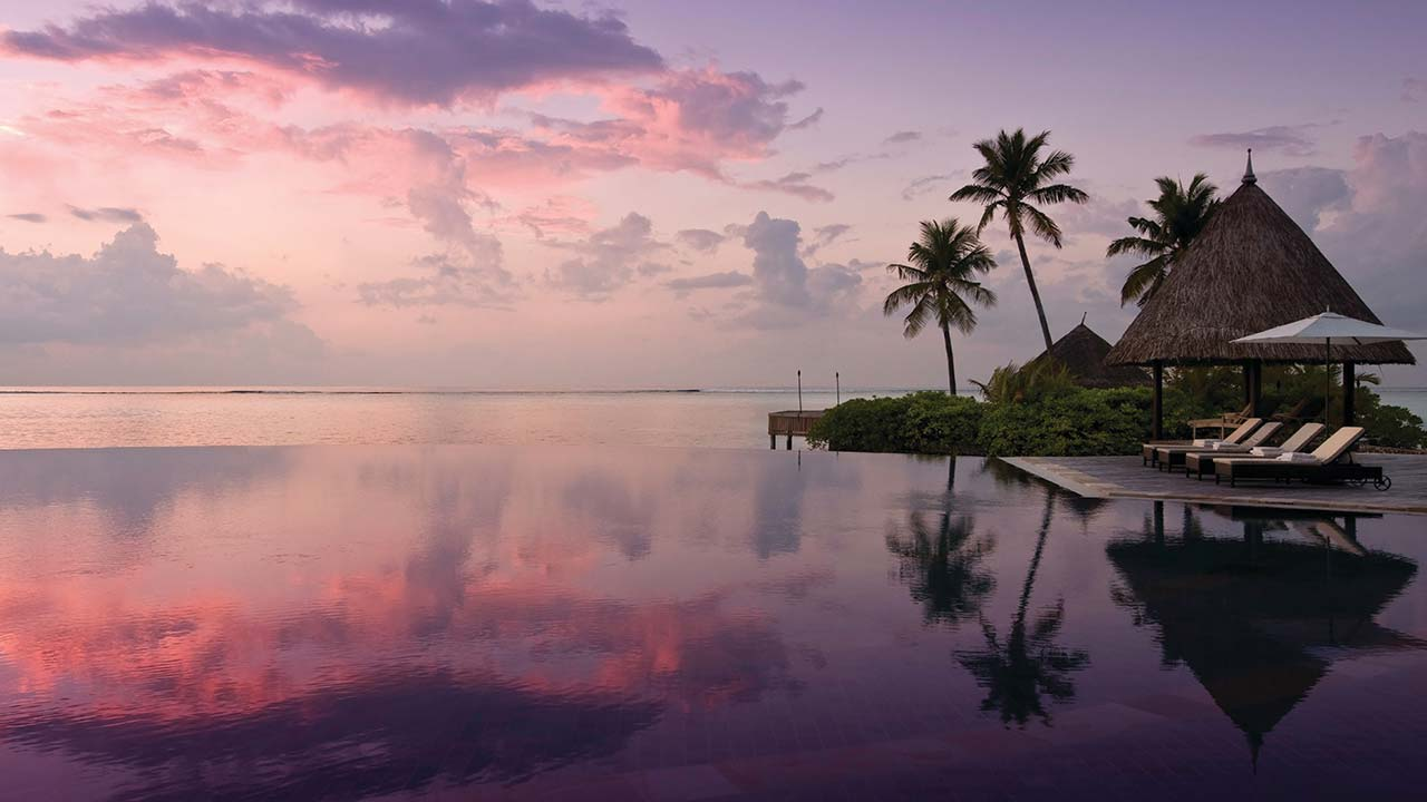 Sunset at the serenity pool at Four Seasons Resort Maldives Kuda Huraa