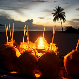 Coconut rum cocktails at sunset in the Maldives