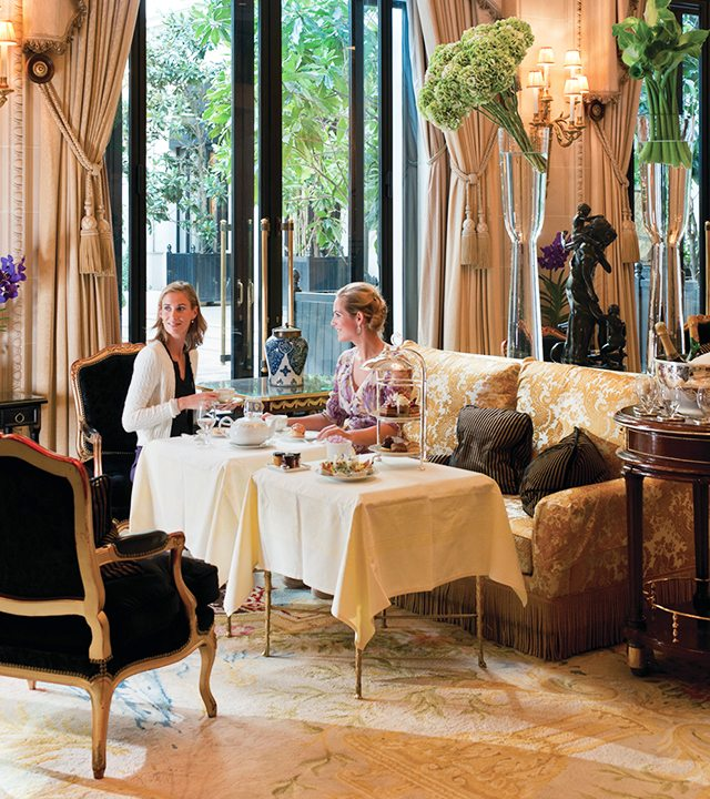 Friends enjoy high tea at Le Galerie lounge at Four Seasons Hotel George V—Paris, France