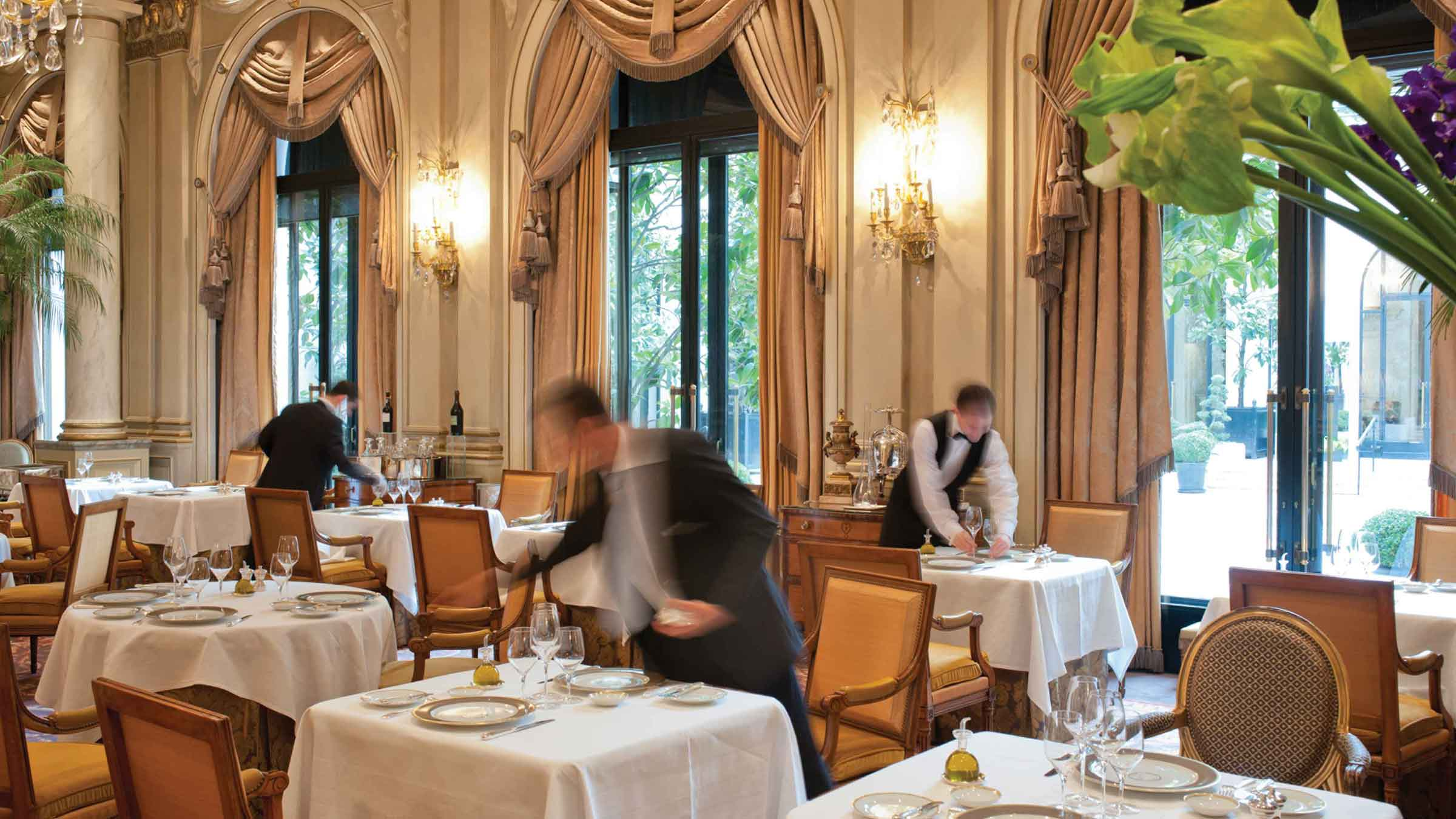 Waiters prepare the dining room at Le Cinq restaurant at Four Seasons Hotel George V—Paris, France