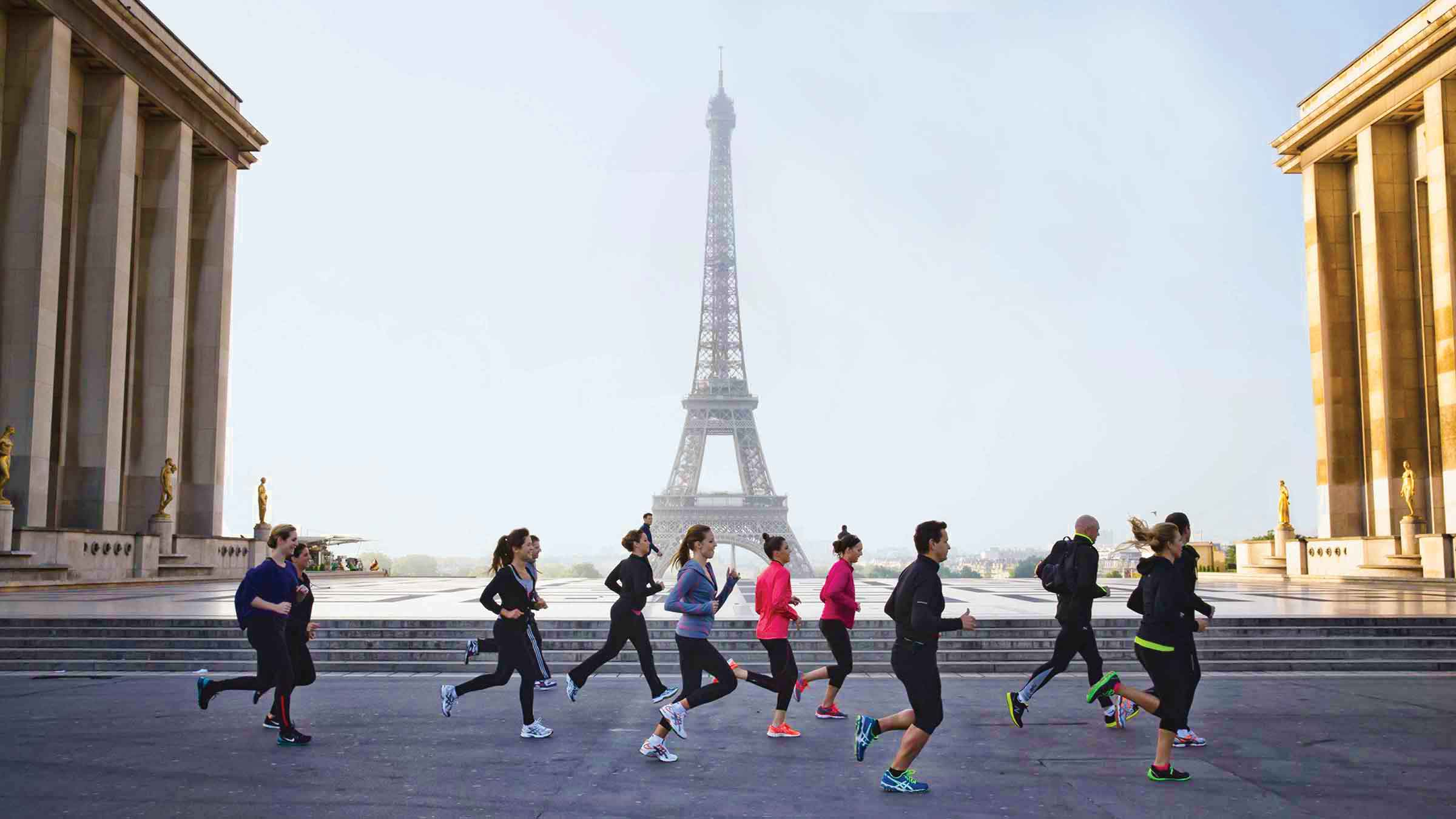 Four Seasons Hotel guests jogging past the Eiffel Tower—Paris, France