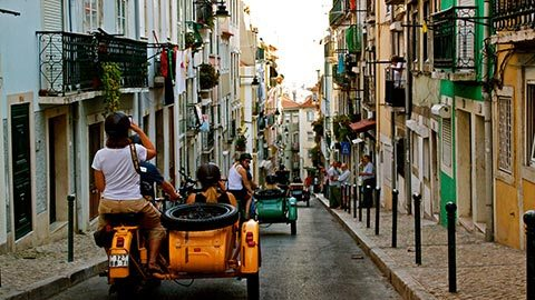 Capture Lisbon's beauty from a moto-sidecar during a thrilling photography tour