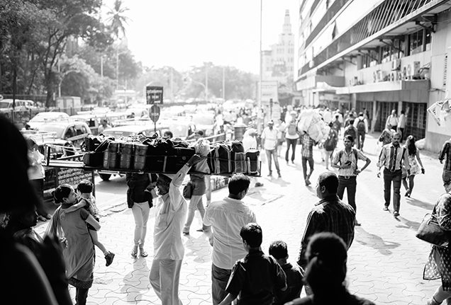 Mumbai dabbawala delivering lunches