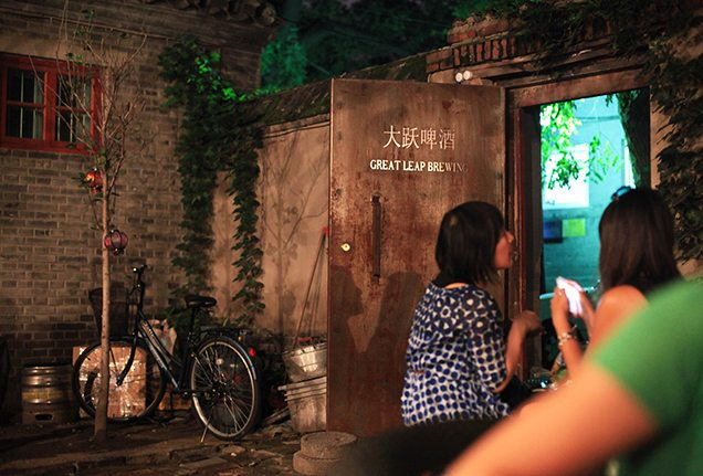 People on the courtyard of Great Leap Brewing Co. in Beijing