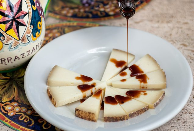 Cheese and balsamic vinegar during a wine tasting at Vincigliata Castle, Florence