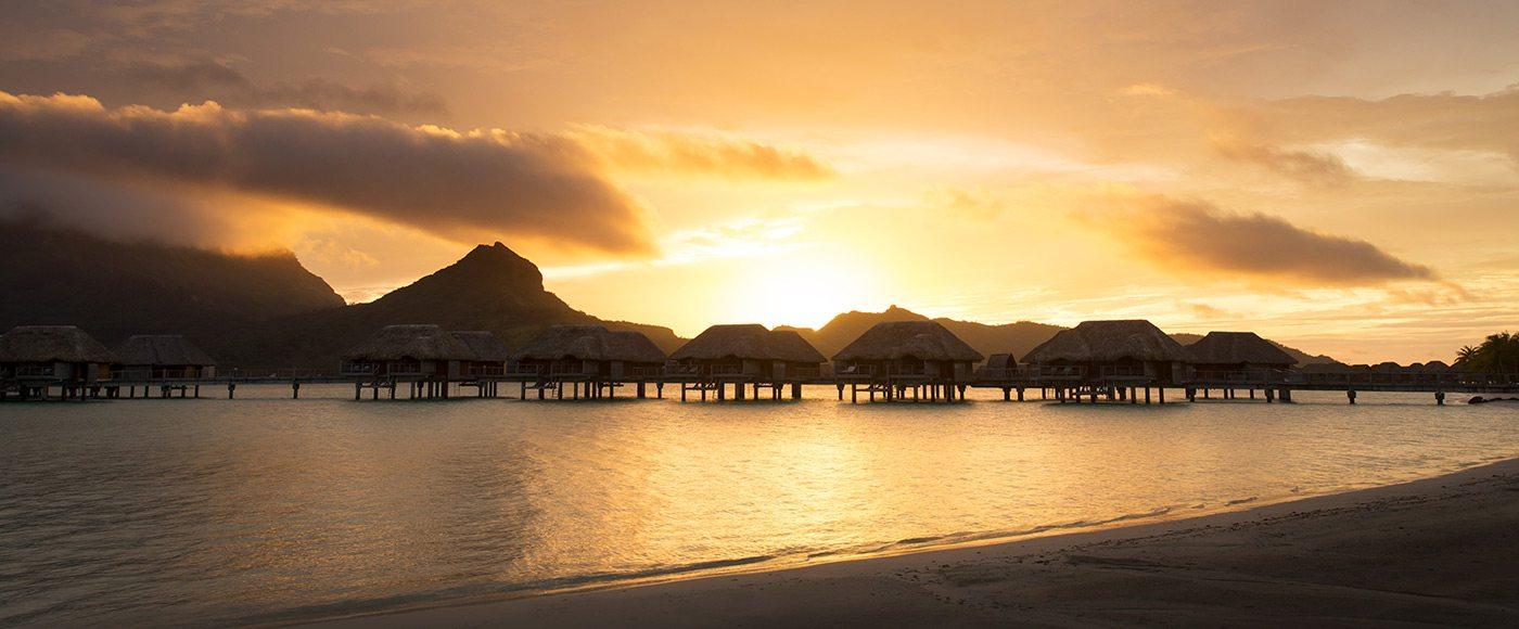 Four Seasons Bora Bora over-water bungalows at sunset
