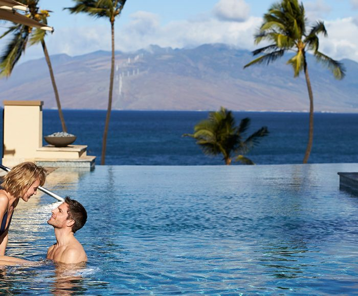 couple in the pool in Maui