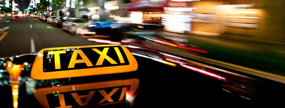 Taxi sign in city
