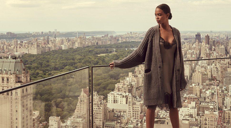 Woman on balcony overlooking New York City