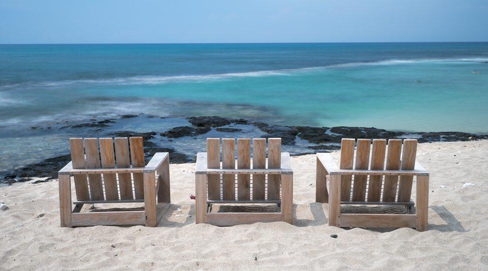 Three chairs by the beach