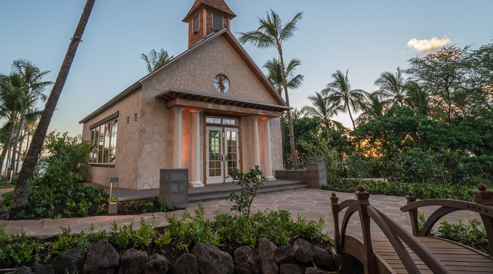 A chapel surrounded by palm trees