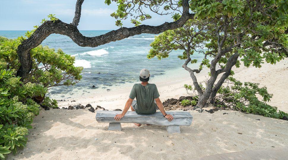 A man sitting by the beach
