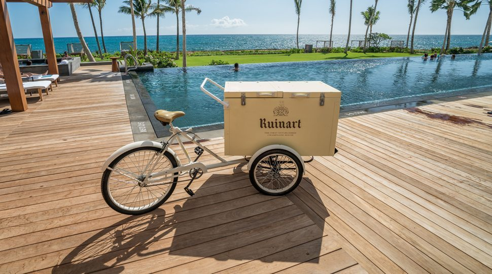 A delivery cart by pool in Oahu