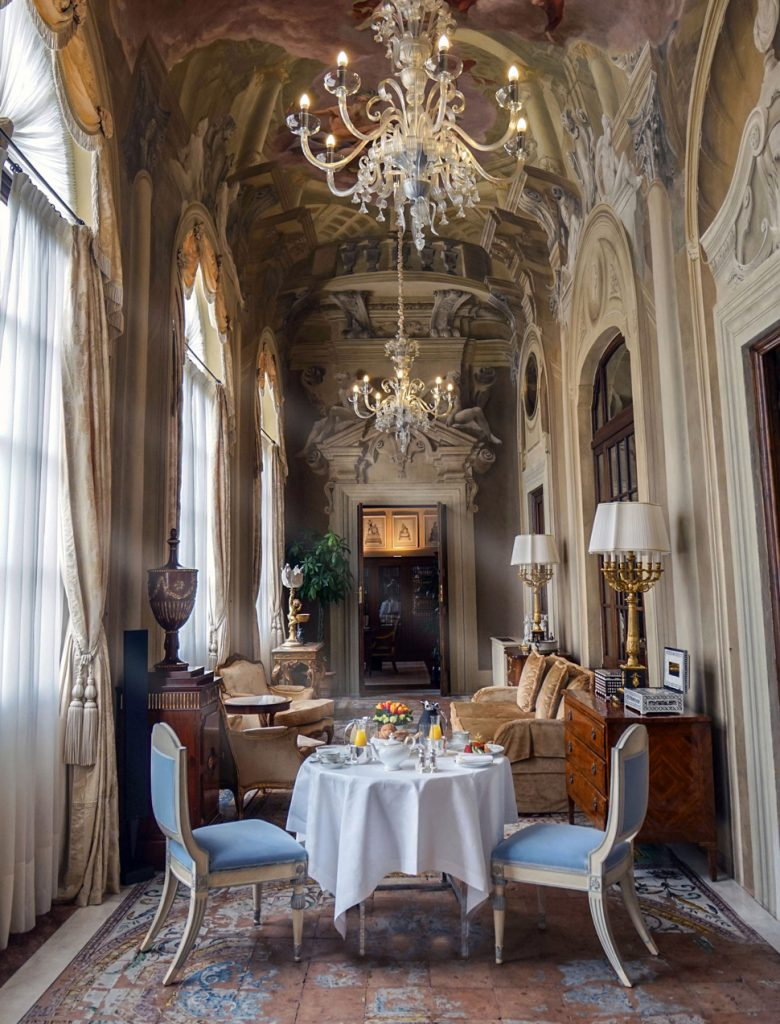 A dining table under a chandelier