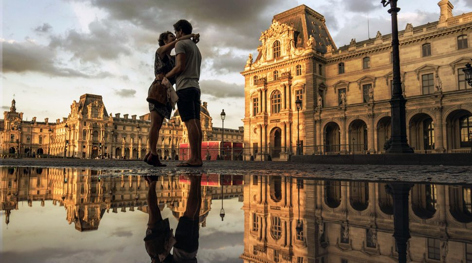 Couple in front of the Louvre