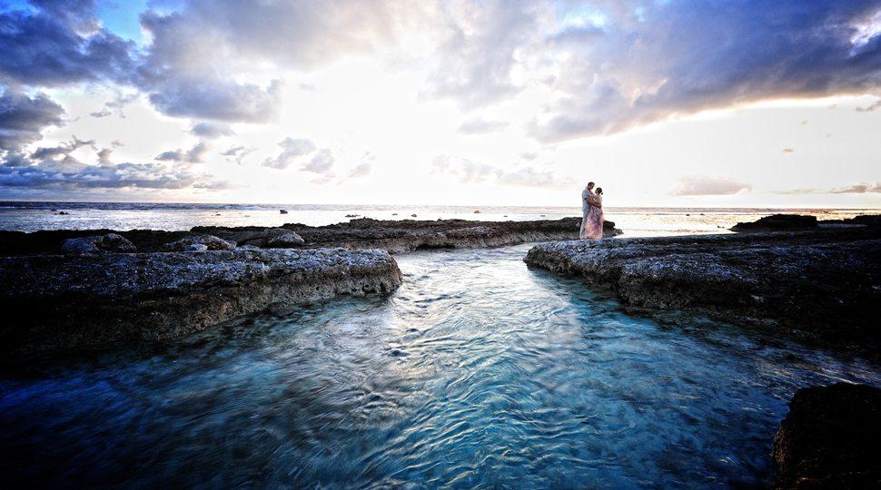 A couple standing near water in Bora Bora