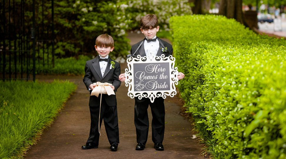 Two children holding a sign