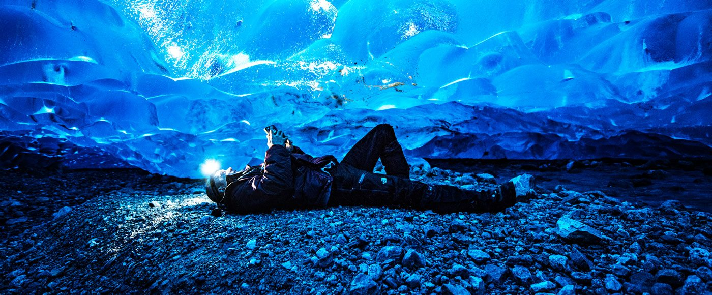 Man laying in ice cave