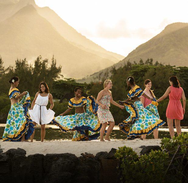 A group dancing on a beach