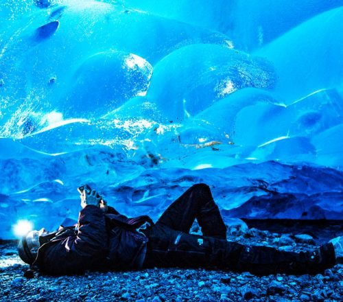 Lying on the ice cave floor in Whistler