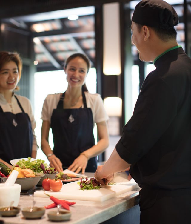 Two people taking chef class in Vietnam