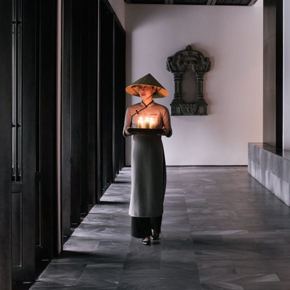 A woman holding candles in Vietnam