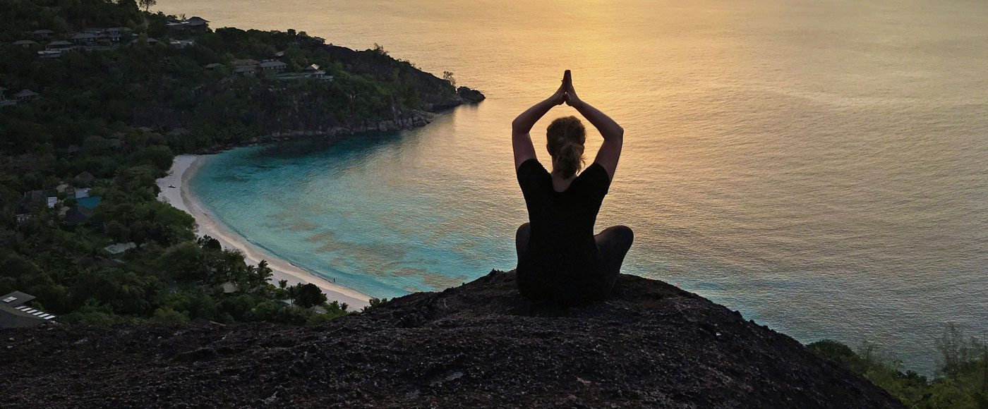 Yoga on a cliff in the Seychelles