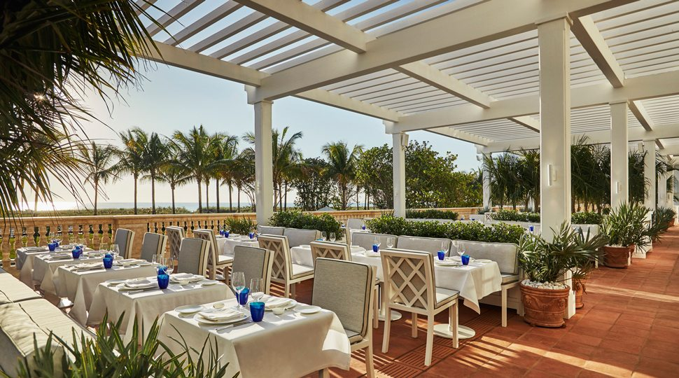Sunny outdoor dinning at the Four Seasons Surf Club Resort