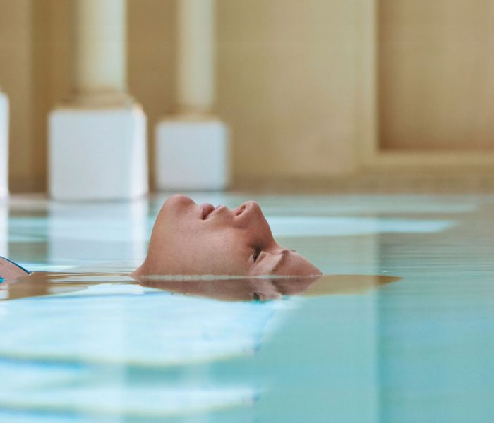 A woman submerging her body in water