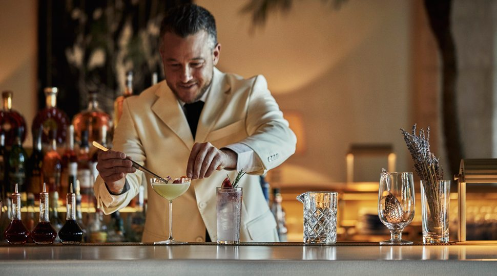 A bartender at Four Seasons Surf Club Resort