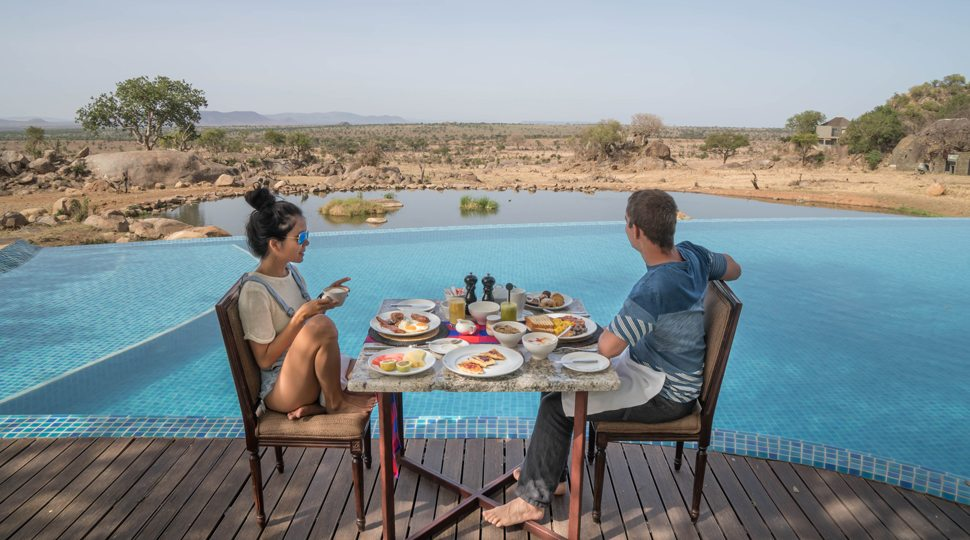 Bloggers Marcy Yu and Robert Michael Pool enjoy a private breakfast at the Four Seasons Serengeti