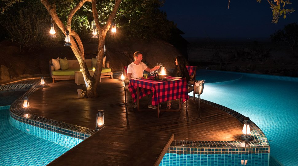 Bloggers Marcy Yu and Robert Michael Pool enjoy a private dinner at the Four Seasons Serengeti