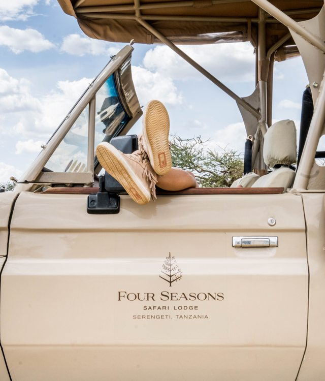 A pair of shoes peak out of a Four Seasons Serengeti Safari tour jeep.