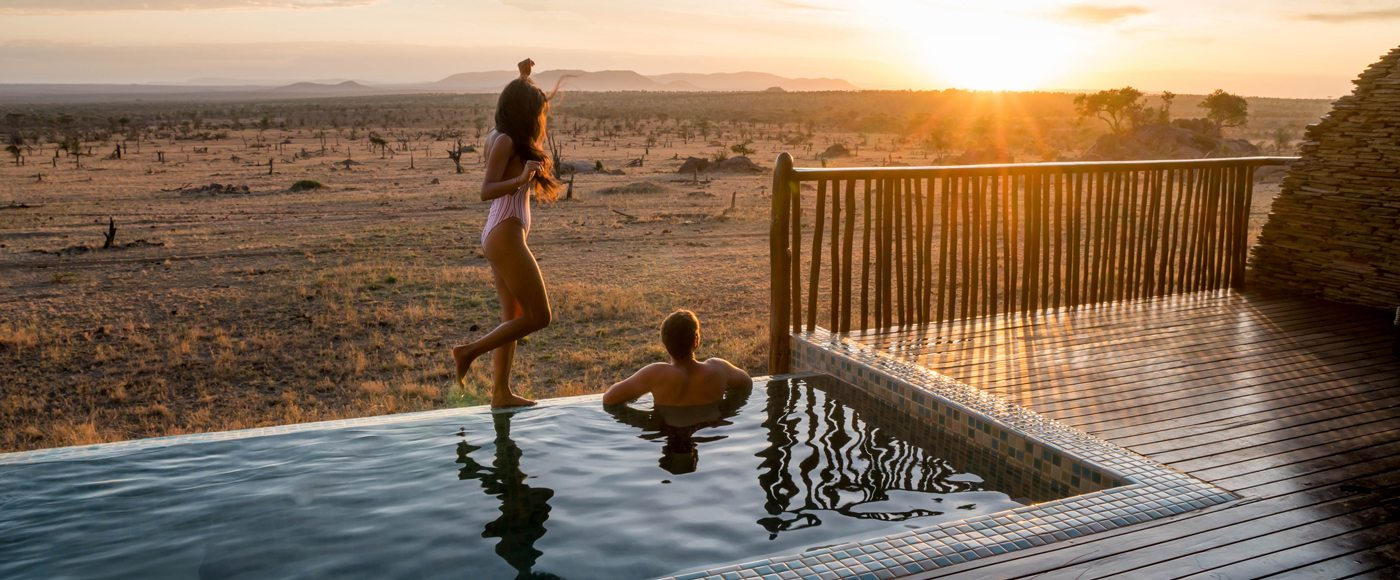 Photographer Robert Michael Poole and his partner, Marcy Yu, enjoying sunset at their private infinity pool at Four Seasons Safari Lodge Serengeti.