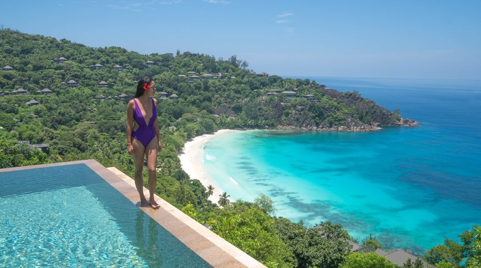 Marcy Yu walks the edge of her private infinity pool at the Four Seasons Seychelles