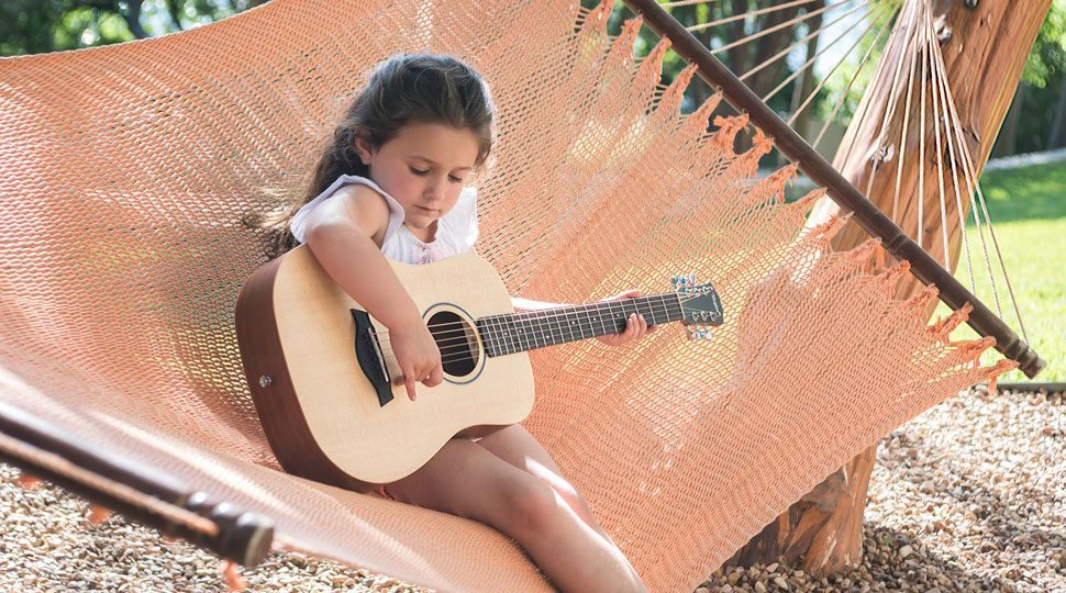 A guitar lesson at the Four Seasons Hotel Austin