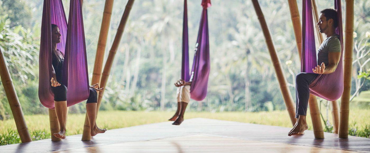 An Antigravity yoga class in sesson at Four Seasons Bali