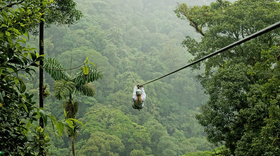 A woman zip-lines in Costa Rica