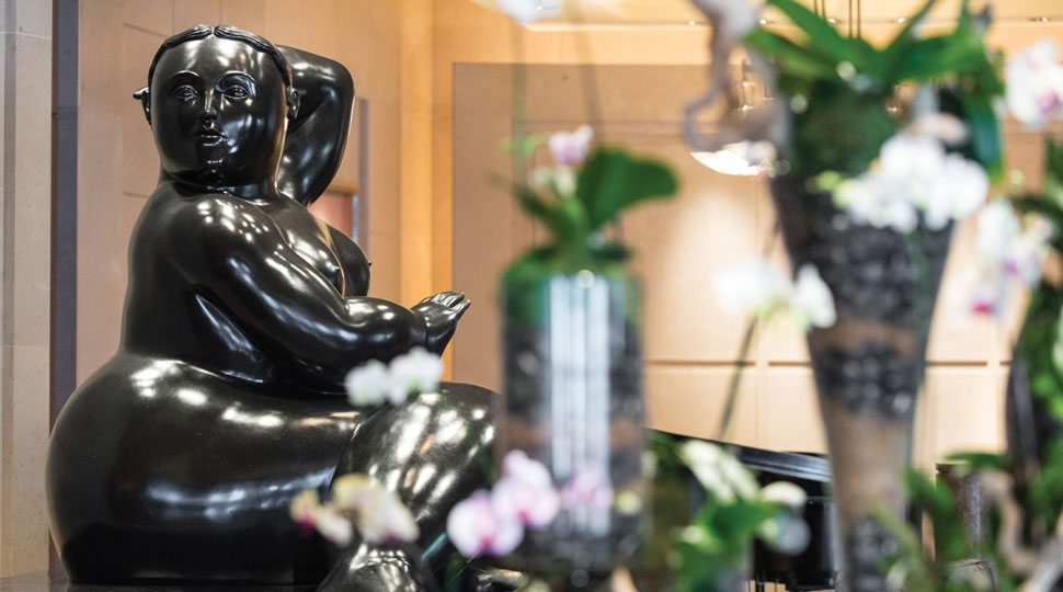 Fernando Botero's Adam and Eve welcome guests entering Four Seasons Miami